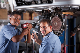Auto Mechanics working in a shop