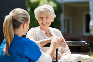 smiling senior sitting with a nurse