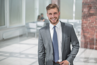 Smiling businessman standing outside