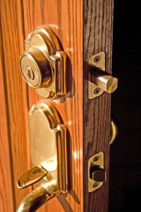 A deadbolt lock on a wooden door