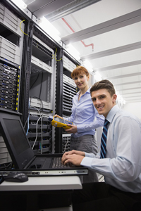 Network administrators in a server room