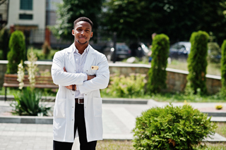 Male nurse standing outside