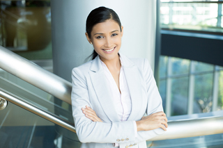 Smiling businesswoman in a modern building